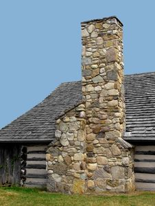 Free Stone Chimney On A Log Cabin. Stock Images - 27826974