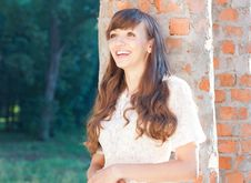 Free Girl Near A Brick Columns Rejoices Her New Home Stock Images - 27830534
