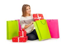Free Young Woman Puts Gift In Shopping Bags Royalty Free Stock Photos - 27834038