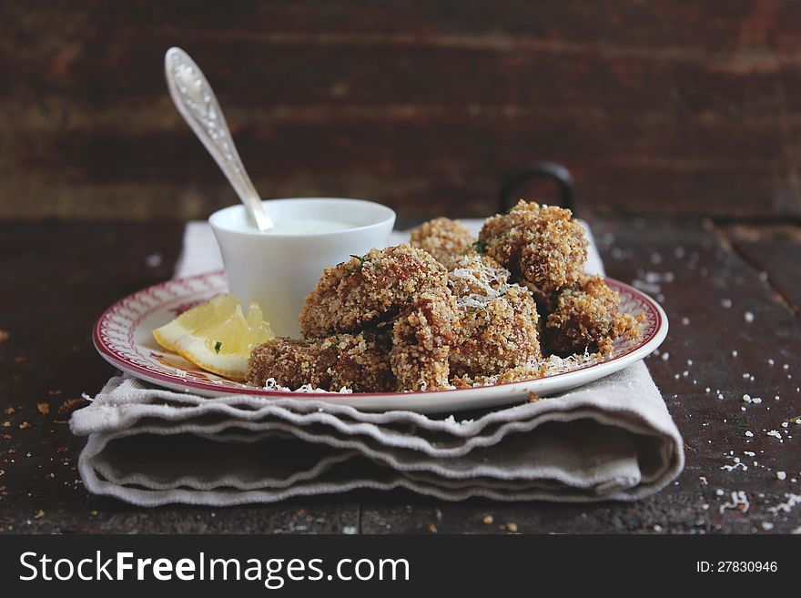 Chicken pieces in parmesan and bread crumbs