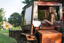 Free Farmer Girl Driving A Tractor Royalty Free Stock Photography - 27857647