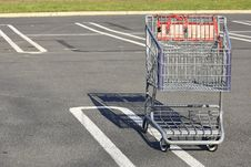 Free SHOPPING CART TROLLY IN A PARKING LOT Stock Photo - 27858420