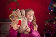 Free Happy Child With Christmas Gift Stock Photo - 27875000