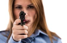 Free Lady Cop Posing With Gun Royalty Free Stock Image - 27884966
