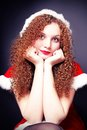 Free Pretty Curly Girl In A Santa Suit Stock Photo - 27890750