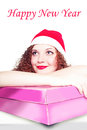 Free Portrait Of Curly Girl As Santa With A Gift Royalty Free Stock Photography - 27890927