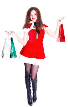 Long-legged Girl Dressed As Santa With Shopping Stock Photography