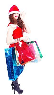 Cute Long-legged Girl As Santa With Shopping Royalty Free Stock Image