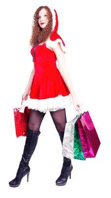 Pretty Long-legged Girl  As Santa With Shopping Royalty Free Stock Image