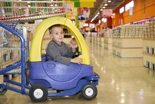 Free Child In The Toy Automobile Royalty Free Stock Image - 2794326