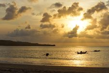 Free Three Outrigger Canoes At Sunset Royalty Free Stock Images - 27902329