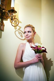 Free Handsome Bride Standing Near Lights Candles Stock Photography - 27902812