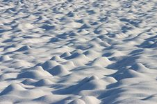 Dunes Of Snow In A Country Field Royalty Free Stock Image