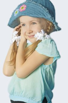 Portrait Of A Cute Little Girl In Hat Smiling Stock Photography