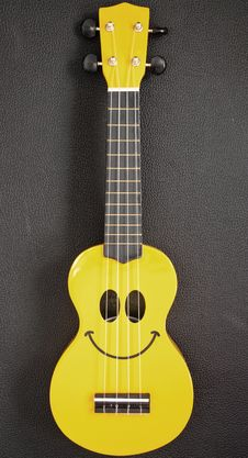 Free Smiley Ukulele Royalty Free Stock Photo - 27910465