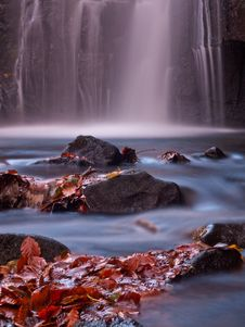 Free Autumn Leaves At The Bottom Of A Waterfall Royalty Free Stock Image - 27912946