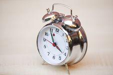 Old Alarm Clock On Wood Background Stock Photos