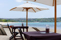 Free Tables And Umbrellas On A Tropical Beach Stock Photography - 27931282