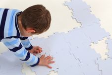 Free Boy Doing A Jigsaw On The White Background Royalty Free Stock Images - 27933189