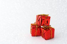 Free Red Gift Boxes In Snow Stock Image - 27935661
