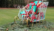 Free Christmas Sleigh Filled With Colorful Presents Royalty Free Stock Photo - 27936635