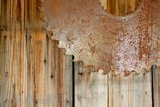 Free Rusty Saw Blade And Wood Stock Image - 27936761