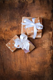 Free Christmas Boxes On A Wooden Surface Stock Photos - 27938983