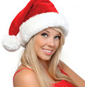 Free Beautiful Girl In A Red Christmas Hat Royalty Free Stock Photography - 27941577