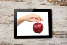Tablet Computer With The Hand A Red Apple Royalty Free Stock Images
