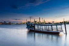Free Boat With Oil Refinery At Twilight Stock Photography - 27944662