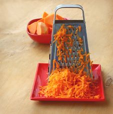 Free A Grater And Pieces Of Pumpkin Royalty Free Stock Images - 27945759