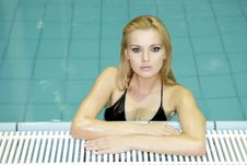 Free Beautiful Young Woman Standing In A Swimming Pool Royalty Free Stock Image - 27945866