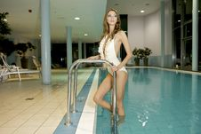 Free Beautiful Young Woman Standing In A Swimming Pool Royalty Free Stock Image - 27945986