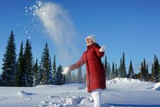 Free Girl Throws Snow Up In A Sunny Afternoon. Royalty Free Stock Photo - 27948805