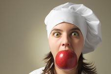 Crazy Chef With An Apple Stock Image