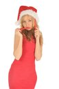 Free Attractive Woman In Santa Cap With Chili Pepper Stock Images - 27967294