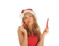 Free Attractive Woman In Santa Cap With Chili Pepper Royalty Free Stock Images - 27967349