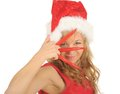 Free Attractive Woman In Santa Cap With Chili Pepper Royalty Free Stock Photos - 27967438