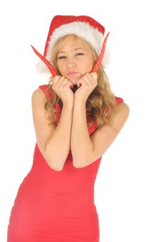 Attractive Woman In Santa Cap With Chili Pepper Stock Images