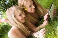 Free Girls And A Touchpad Stock Photography - 27975812