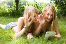 Free Girls Waving With A Tablet Royalty Free Stock Image - 27975816