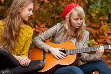 Free Playing Guitar In The Forest Stock Photos - 27976223