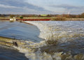 Free Flood Water Passing Over A Weir Royalty Free Stock Photo - 27981195