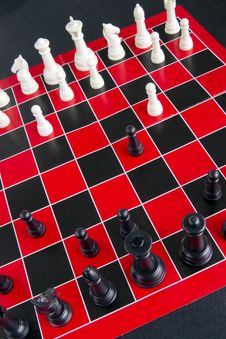 Free Chess Game Pieces Board Red White Black Background Royalty Free Stock Photography - 27983027