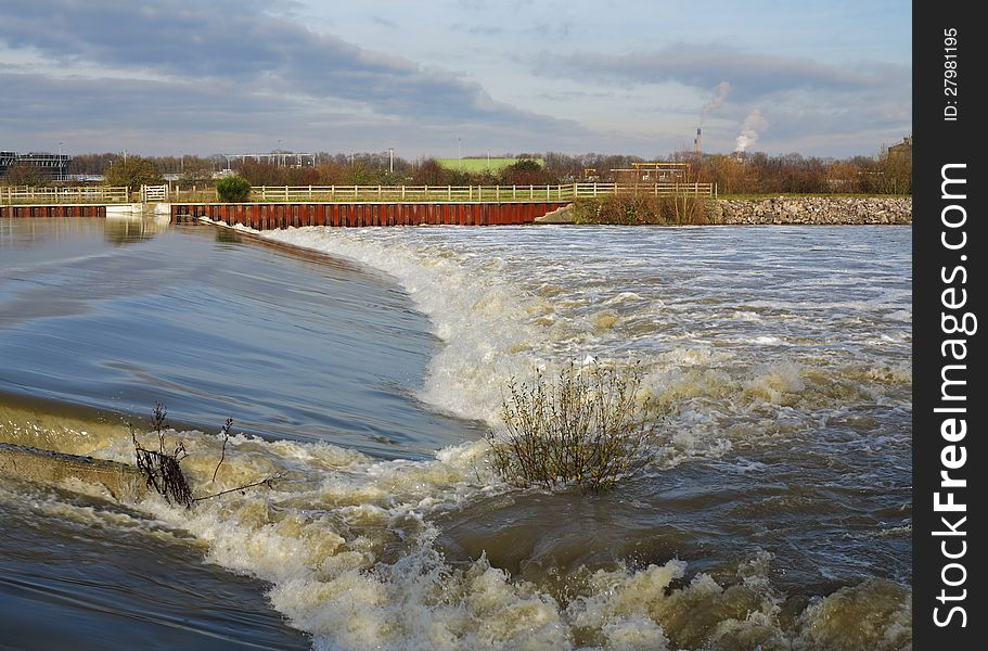 Flood water passing over a Weir