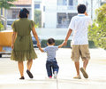 Free Parents Holding Hand Of His Son Royalty Free Stock Images - 27999279