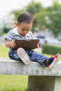Free Little Boy Staring At A Tablet Stock Images - 27999394