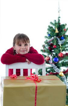 Free Dreaming Girl With Big Xmas Present Royalty Free Stock Image - 27994196
