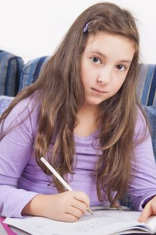 Free Girl Writting Homework Royalty Free Stock Photography - 27997077