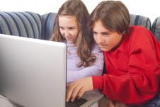 Free Brother And Sister Playing Games On Laptop Stock Photos - 27997163